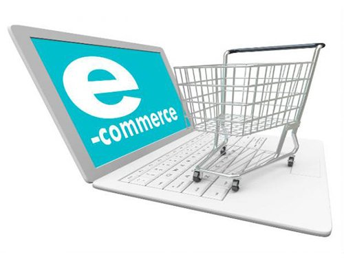 Ecommerce Website Designers in San Francisco png  of ecommerce cart on top  of computer